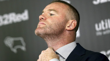Gaffer-in-the-making: Wayne Rooney gets comfortable at the announcement of his deal with Derby at Pride Park.