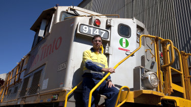 Rio Tinto iron ore managing director rail, port and core services Ivan Vella on one of the Autohaul locomotives.