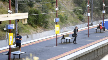 Melbourne commuters wait on a  platform at Elsternwick railway station on Monday morning.