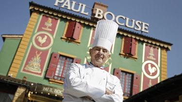 Chef Paul Bocuse outside his famed restaurant in 2011.