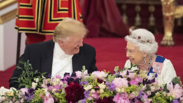 US President Donald Trump and the Queen laugh during a state banquet at Buckingham Palace.