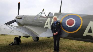 RAF Veteran World War II pilot Mary Ellis posing with a Spitfire at Biggin Hill Airfield, England.