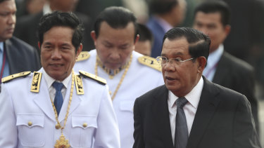 Cambodian Prime Minister Hun Sen, right, says his government has defeated an attempted coup.