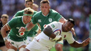 Running riot: Manu Tuilagi scores his side's third try in what quickly became a rout.
