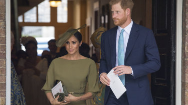 Harry and Meghan, Duchess of Sussex, leave after the christening service.