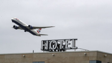 A plane passes over the Sofitel Hotel near London's Heathrow.