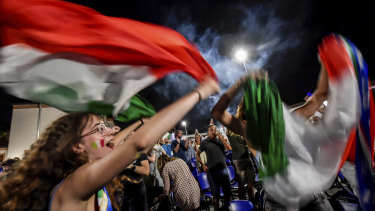 Fans celebrate in the streets of Milan after Italy beat Spain on penalties.