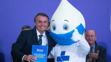 "Mixed messages: Brazilian President Jair Bolsonaro who has said he won't take a COVID-19 vaccine, poses with the mascot of his nation's vaccination campaign, named ""Ze Gotinha"" or Joe Droplet."