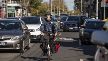 President of Revitalise Sydney Road Nic Dow. (Mr Dow is exempt from wearing a helmet.)