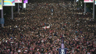 Fans celebrate outside Wembley Stadium after England qualified for the Euro 2020 final.