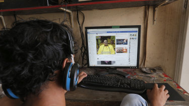 A young Indonesian browses his Facebook page at an internet cafe in Jakarta. Only one in six Indonesian homes has an internet connection.