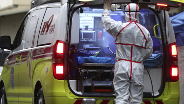 A worker wearing a protective suit sprays disinfectant in an ambulance at Dongsan Medical Centre in Daegu, South Korea.