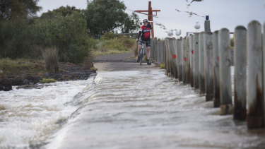 Ford Road in Altona is flooded after wild weather and a heavy downpour of rain overnight.