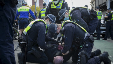 Violence broke out between police and protesters at a rally in Melbourne.