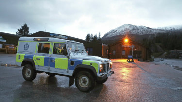 A police vehicle near the scene at the Nevis Range Mountain Resort with Ben Nevis in the background, in Scotland.