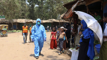 A health aid worker wears a hazmat suit at the Kutupalong Rohingya refugee camp in Cox's Bazar, Bangladesh.