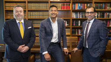 Stuart Wood, QC (left) with his client Israel Folau (centre) and legal collaborator George Haros (right).