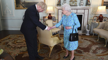 It was soon hot in London this week, a modern portable air-conditioning tower can be seen among the period decoration of Buckingham Palace reception room where the Queen invited Boris Johnson to become prime minister.