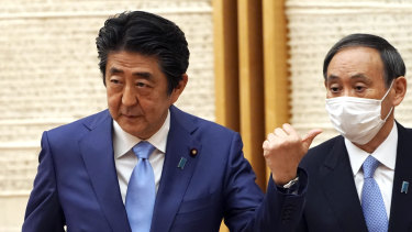 Japan's Prime Minister Shinzo Abe and his Chief Cabinet Secretary Yoshihide Suga.