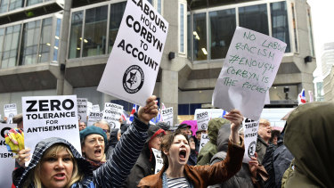 Protesters chant slogans during a demonstration organised by the Campaign Against Anti-Semitism against alleged prejudice in the Labour Party, amid a row over the party's handling of claims of anti-Semitism.