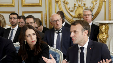 French President Emmanuel Macron and New Zealand's Prime Minister Jacinda Ardern attend a meeting at the Elysee Palace.