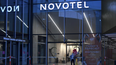 Private contractors overseeing hotel quarantine at Southbank's Novotel were replaced with police on Wednesday.
