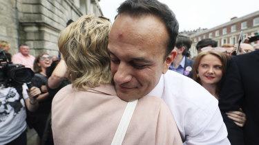 Ireland's Prime Minister Leo Varadkar, at Dublin Castle for the referendum results, embraces Senator Ivana Bacik.