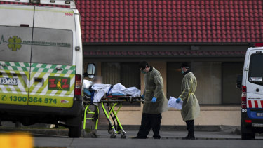A patient is removed from St Basil's Homes for the Aged in the Melbourne suburb of Fawkner on July 25.
