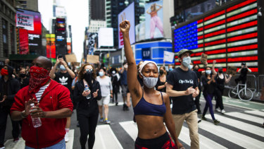 Protesters in New York City's Times Square. By voicing solidarity with the black community, brands are trying to gain credibility
