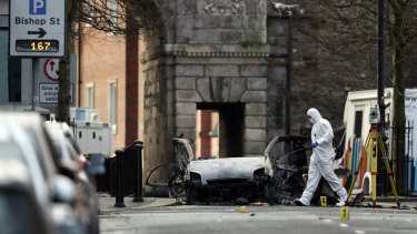 Forensic investigators at the scene of a car bomb in Londonderry, Northern Ireland, in January.