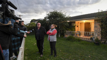 Neighbours Peter Wrighter and Tess Hanna speak to the media.