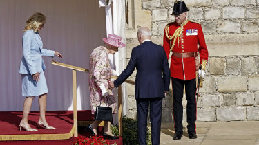 US President Joe Biden, second right, gestures to Queen Elizabeth II, as she descends a set of stairs at Windsor Castle.