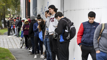 International students and Melburnians impacted by the COVID-19 shutdown line up for food assistance earlier in April.