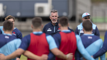 Waratahs coach Rob Penney addresses the playing group at training.