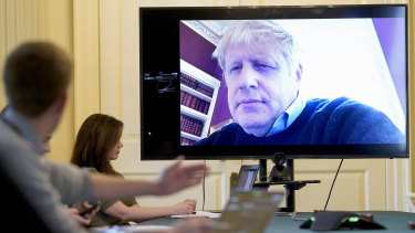 Boris Johnson pictured chairing a recent COVID-19 meeting remotely.