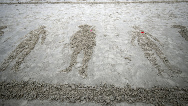 Drawings of soldiers on Sunny Sands beach in Folkestone,  England during the Pages of the Sea commemorative event to mark the 100th anniversary of the end of WWI. The homage to fallen servicemen and women was the idea of filmmaker Danny Boyle and intended as an informal gesture of remembrance.