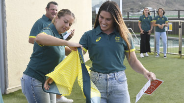 Rugby Sevens star Charlotte Caslick receives her Australian team uniform.