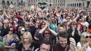 Members of the public celebrate at Dublin Castle, in May after the results of the referendum on the 8th Amendment of the Irish Constitution which prohibited abortion.