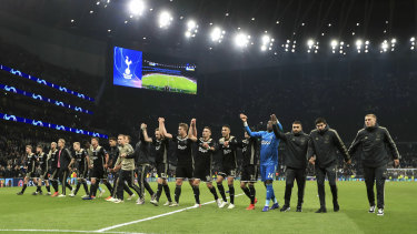 The Ajax players celebrate after the final whistle.