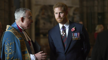 Britain's Prince Harry, the Duke of Sussex listens to the Dean of Westminster Dr John Hall as he leaves the Anzac Day Service of Commemoration and Thanksgiving at Westminster Abbey, in London.
