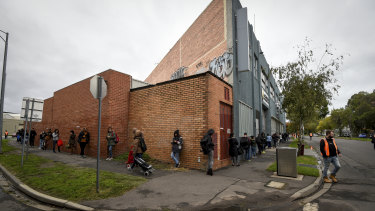 The queue for emergency food relief at a Southbank charity in Melbourne. The coronavirus outbreak has highlighted the nation's dependence on foreign students and casual workers.