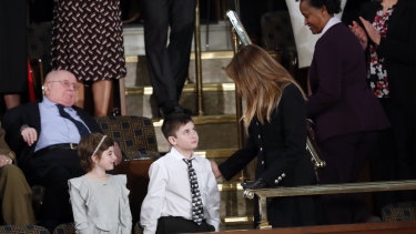 Guests Grace Eline and Joshua Trump, no relation, greet first lady Melania Trump before Donald Trump delivers his speech. Joshua was invited on the account of bullying he has suffered for his surname.