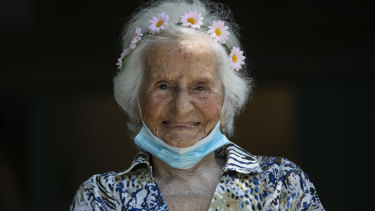 Zelia de Carvalho Morley, 106, smiles after receiving a shot of China's Sinovac CoronaVac vaccine in Rio de Janeiro.