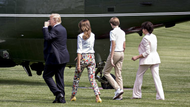 US President Donald Trump, from left, First Lady Melania Trump, their son Barron and Amalija Knavs cross the South Lawn of the White House before boarding Marine One in June.