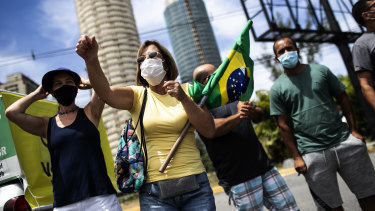 A group of demonstrators formed by former supporters of Brazil's President Jair Bolsonaro protest against the government's response to the pandemic in Rio de Janeiro on Sunday.