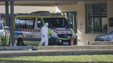 An ambulance at St Basil's Homes for the Aged in Fawkner, where an outbreak has infected 73 people.