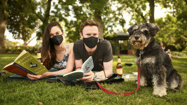 Stevie the three year old Mini Schnauzer with her owners Emma Barker-Perez and Connell Bergin enjoying a beautiful spring day at the St Kilda Botanical Gardens.