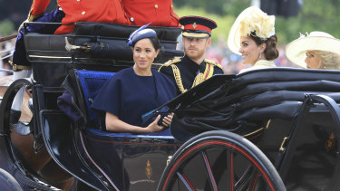 Meghan Duchess of Sussex (left, with Prince Harry and Catherine Duchess of Cambridge and Camilla Duchess of Cornwall) is tipped to be guest-editing British 'Vogue'.