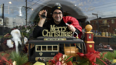 Danny Harb, owner of St Derby's cafe in Pascoe Vale with their Christmas in July window display that they hope will cheer up locals during the second lockdown.