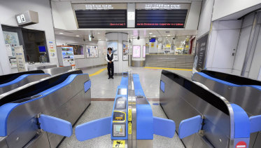 A Tokyo train station falls silent after services were suspended on Sunday.